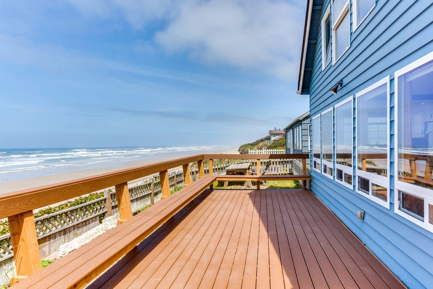 The ocean front deck and a wall of windows make this the perfect spot to vacation!