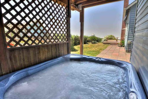 Relax in the hot tub after spending the day beachcombing.