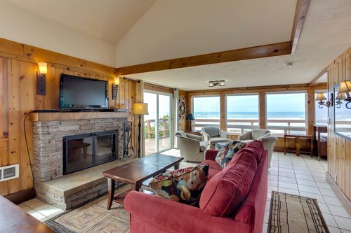 The woodburning fireplace and ocean views make this space a wonderful spot!