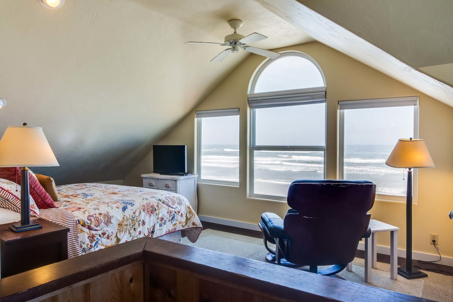 The master bedroom upstairs has a king bed and wonderful ocean views!