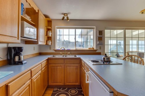 Apartment kitchen is great for morning coffee or a late night snack!
