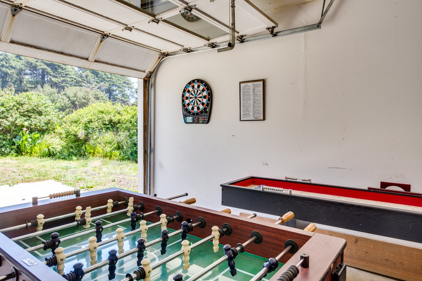 Garage game room with Foosball & shuffleboard.