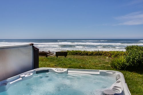 Take time to relax in the hot tub with ocean views.