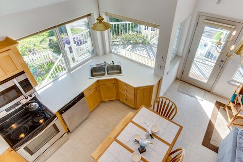 Spacious and bright kitchen with exterior access to the deck.