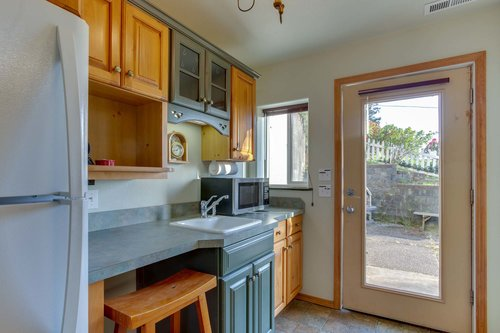 The lower level apartment has a separate private entrance, and a kitchenette.