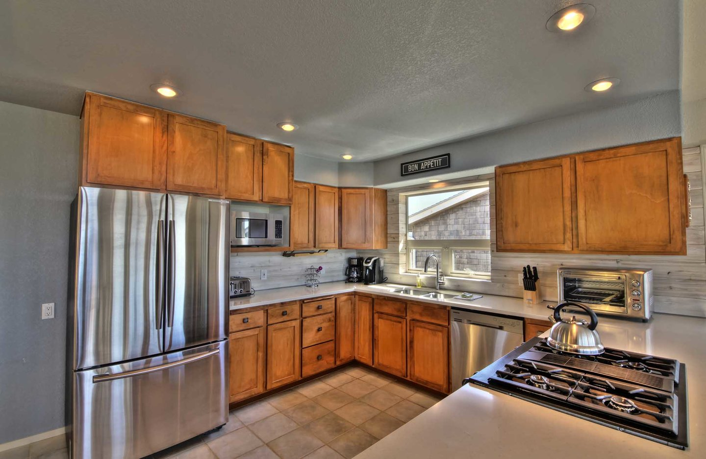 The finest in stainless steel appliances and lovely cabinetry, highlight this chef-worthy kitchen.