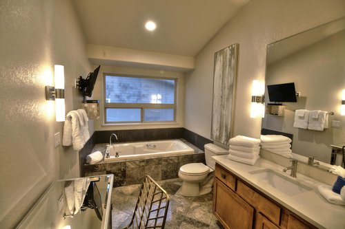 The Master Bath is steeped in luxury with double vanity, tiled walk in shower, soaking tub and TV.