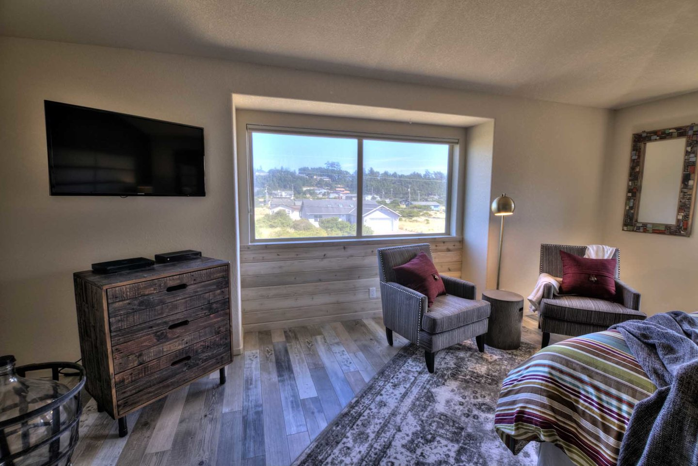 Distinctive comfortable furnishings and bedding, HD TV, and a scenic view.