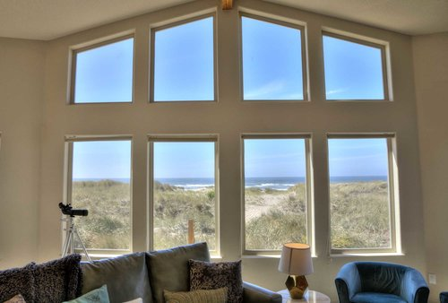 Vaulted ceiling flood this beautiful home with sunlight and views of the Pacific