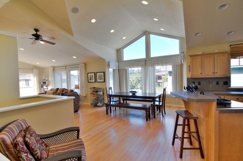 Vaulted ceilings and an open floor plan illuminate this home, ceiling fans keep you cool in the summer.