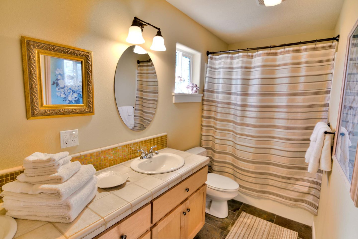 The downstairs bath has plenty of space to share.