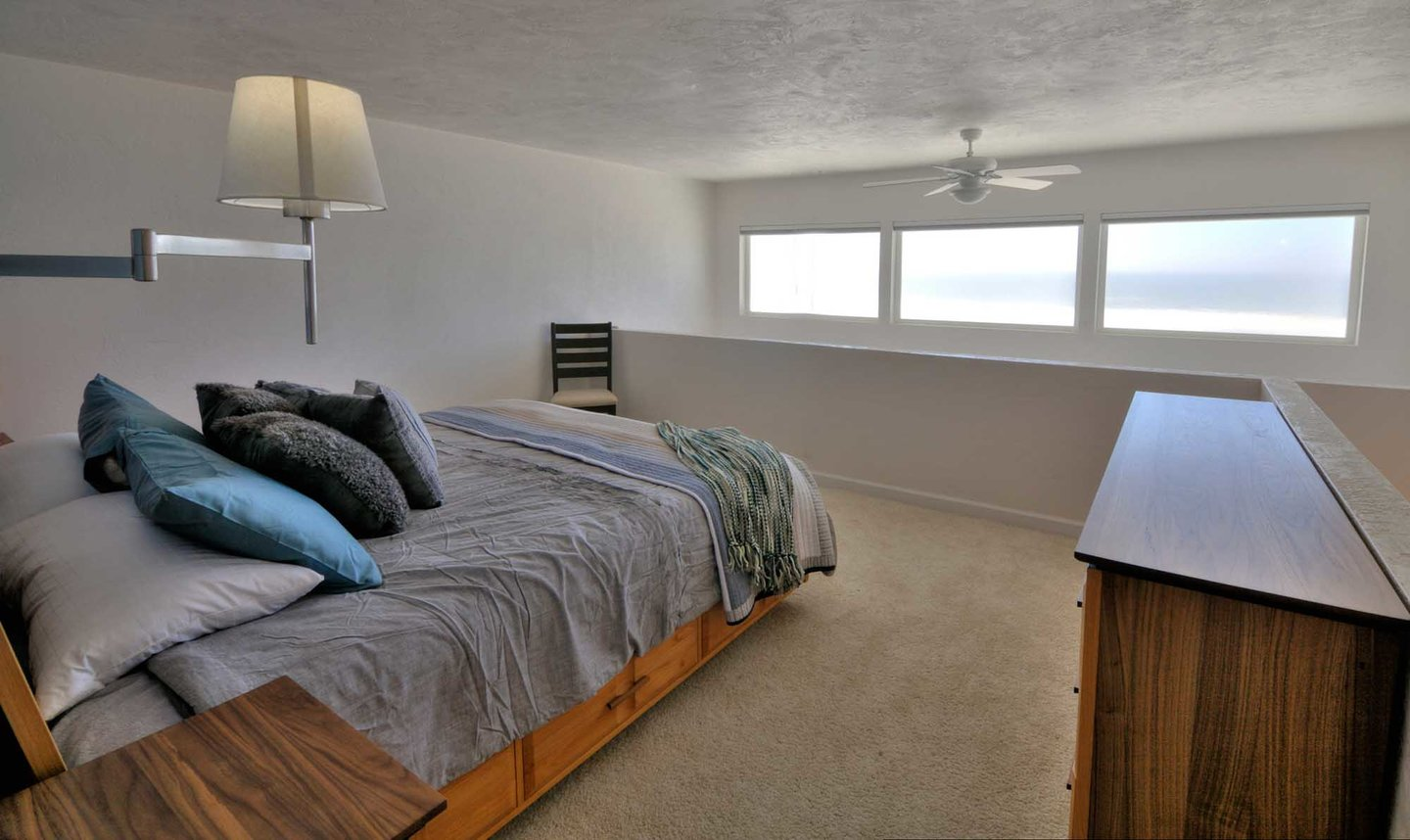 Upstairs is a second loft style bedroom also with en suite bath and ceiling fan.