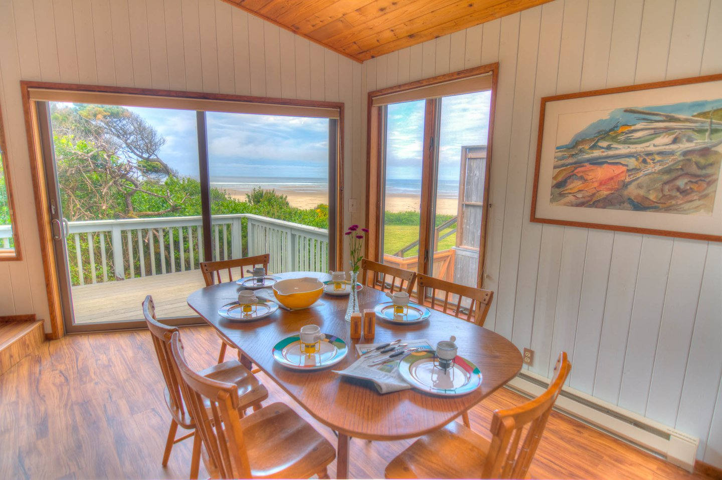 The dining room has a sliding glass door that opens on to the deck to allow the ocean breeze in!