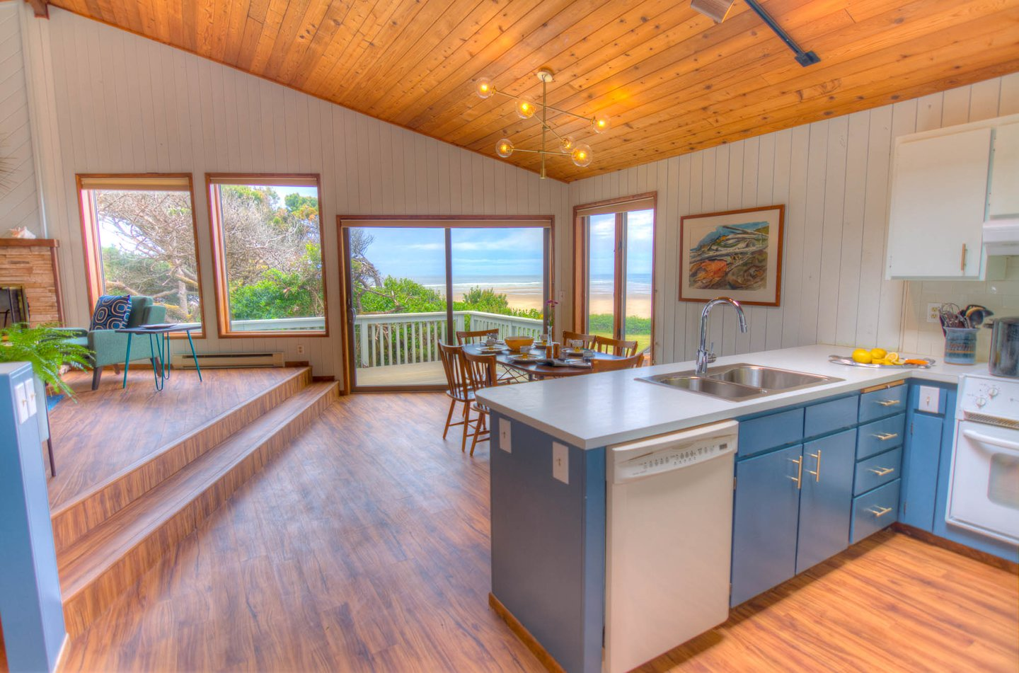 Bright and cheery kitchen has all the amenities.