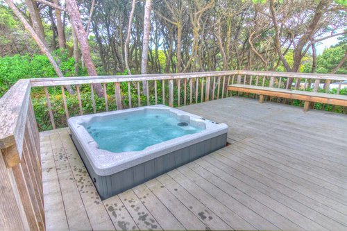 Enjoy the sunken hot tub on the deck surrounded by the shore pines.