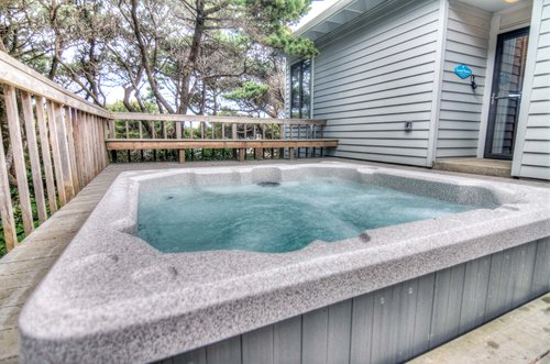 Decompress in the hot bubbly outdoor tub!