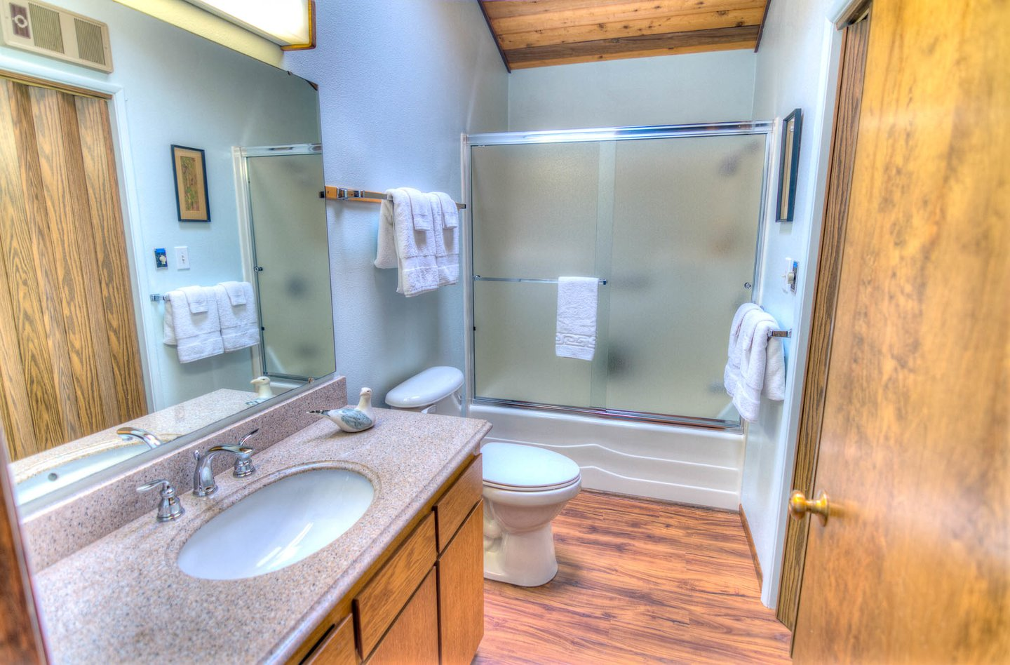 This shared bath in the hallway has plenty of room, including a washer and dryer!