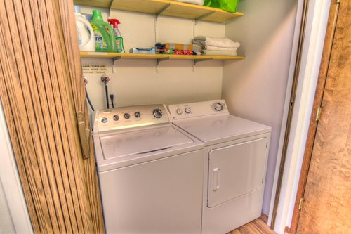 The washer and dryer are tucked in to the hallway bathroom for easy access.
