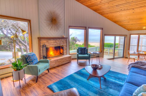 Mid Century Modern decor with a warm wood burning fireplace and beach views!