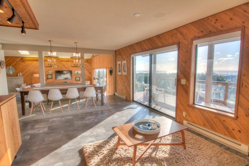 Open and sunny kitchen/dining area with wonderful views.