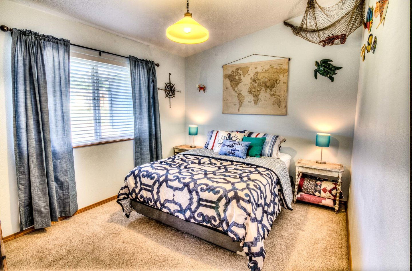 Enjoy the queen size bed in this cheerful bedroom.