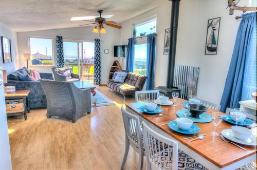The dining is open to the kitchen and the living area.
