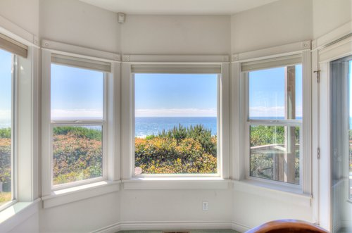 Bay window in the living room offers ocean views.