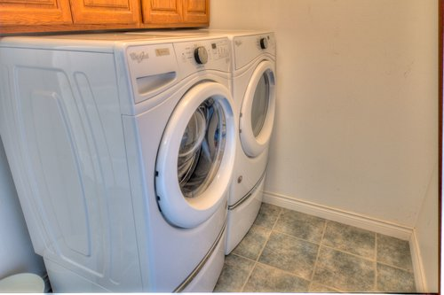 Washer and dryer in laundry room.