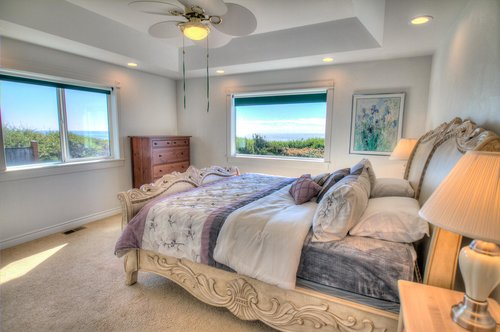 First floor bedroom with king bed and ocean views.