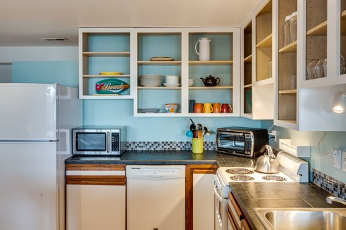 Fully stocked kitchen is perfect to put together a picnic lunch.