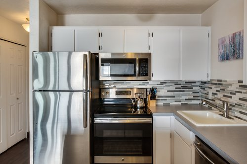 The kitchen is equipped with beautiful stainless appliances.