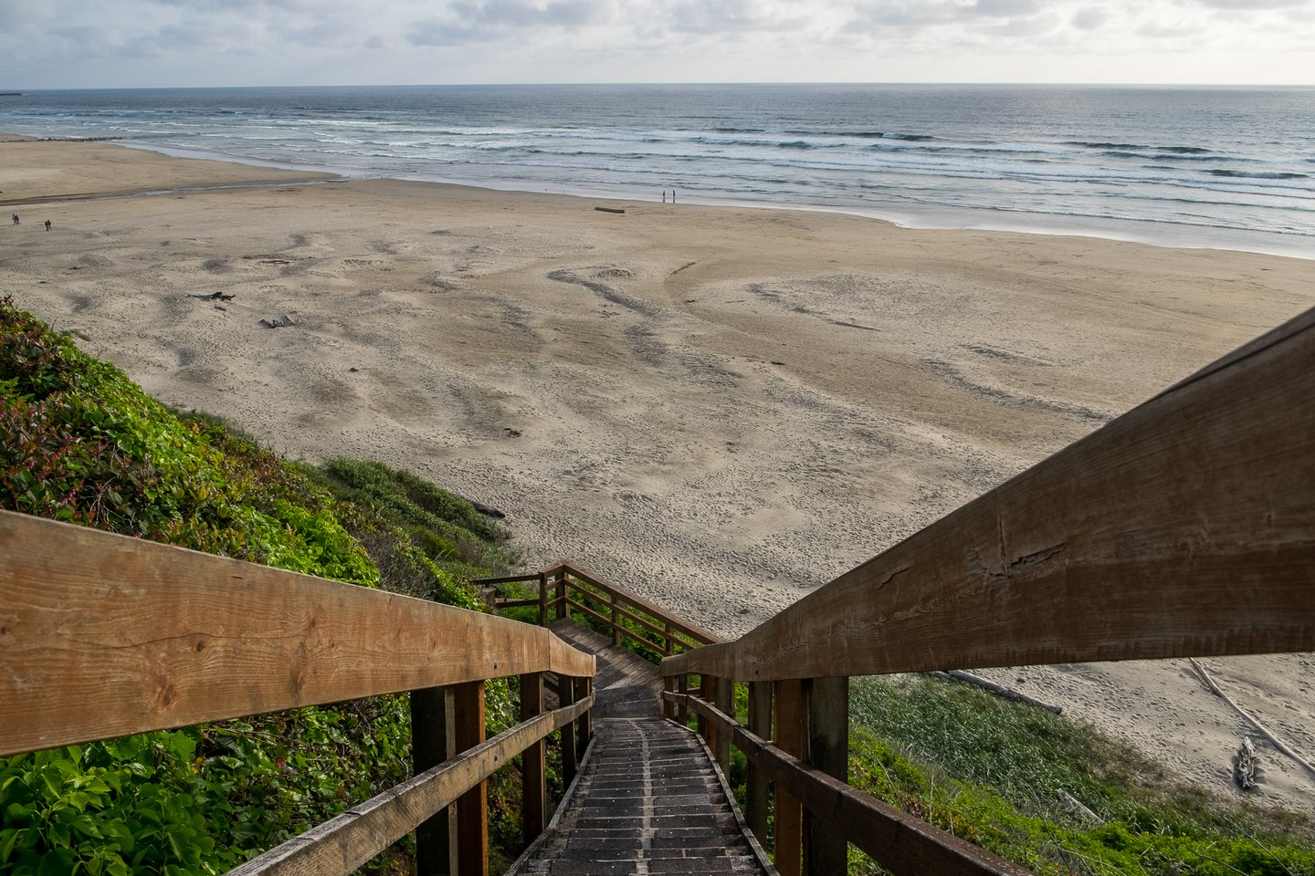 Take the stairs down to a wonderful sandy beach!