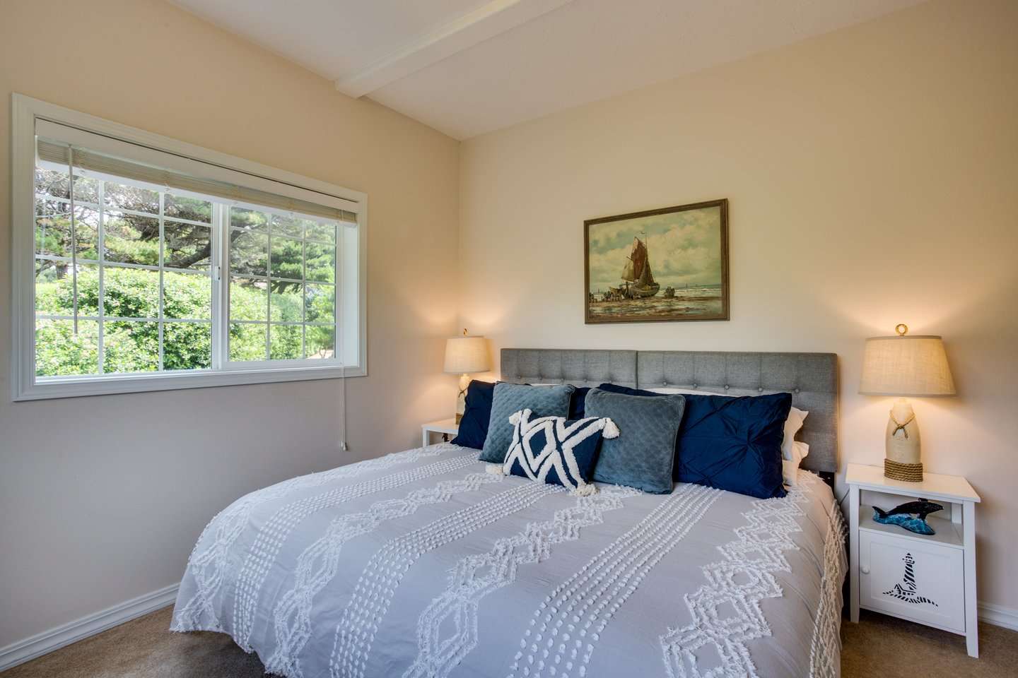 Enjoy this comfy king bed in another sunny bedroom.