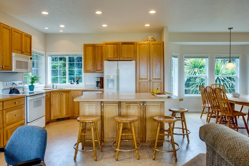 The large kitchen island is a great place for meal prep or morning coffee.