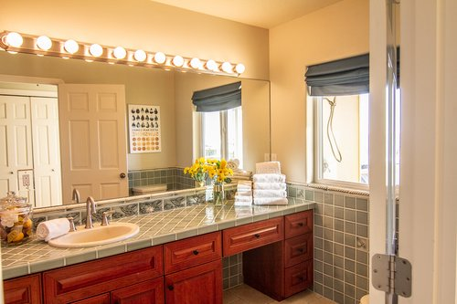 The main floor bathroom has lots of counter space as well as a large shower.