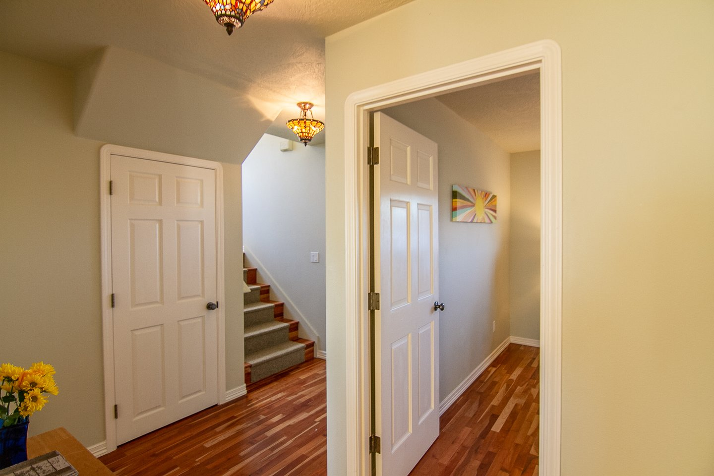 The bright entryway leads to the first two bedrooms as well as upstairs.