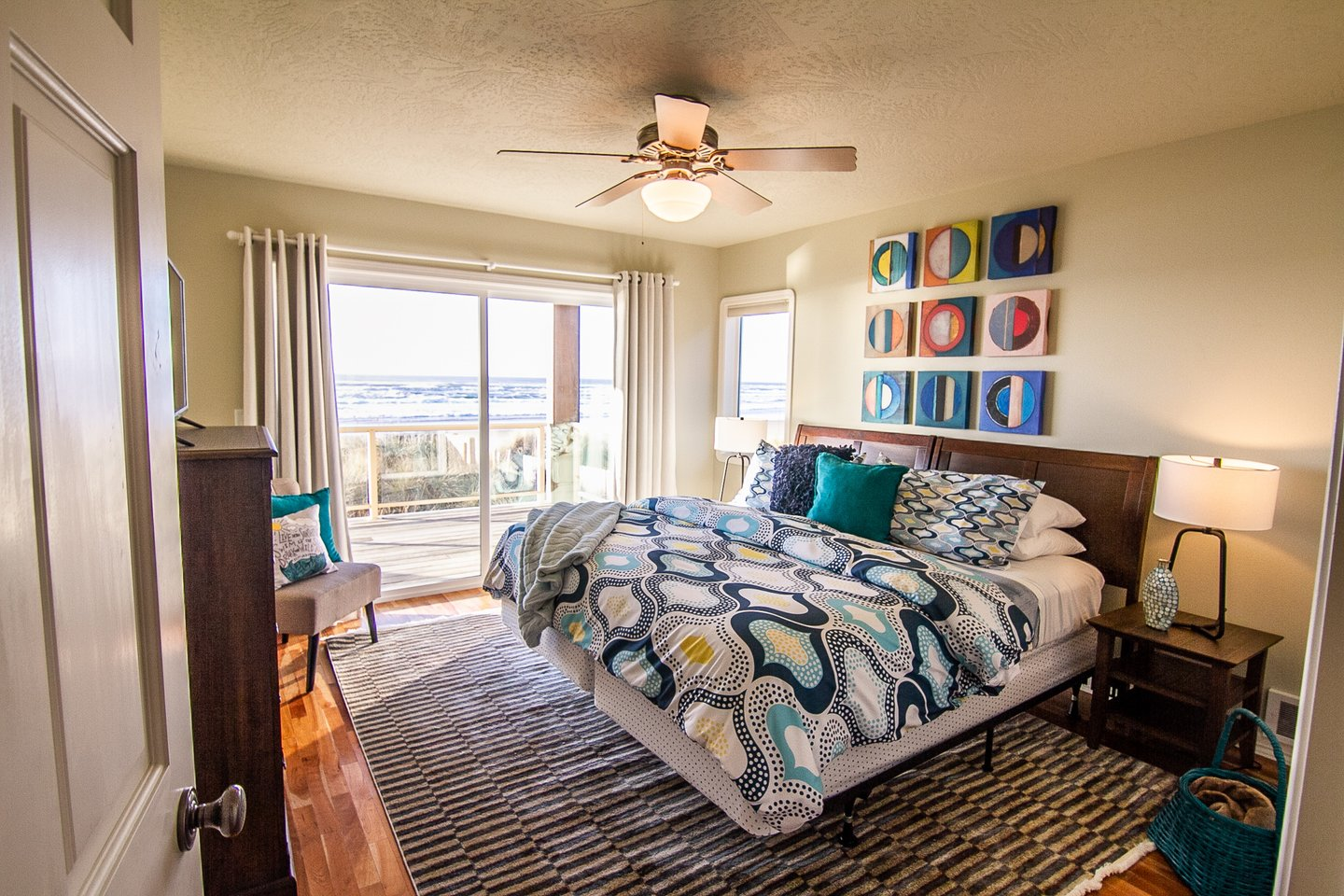 One of the bedrooms downstairs opens up to the back deck with amazing ocean views.