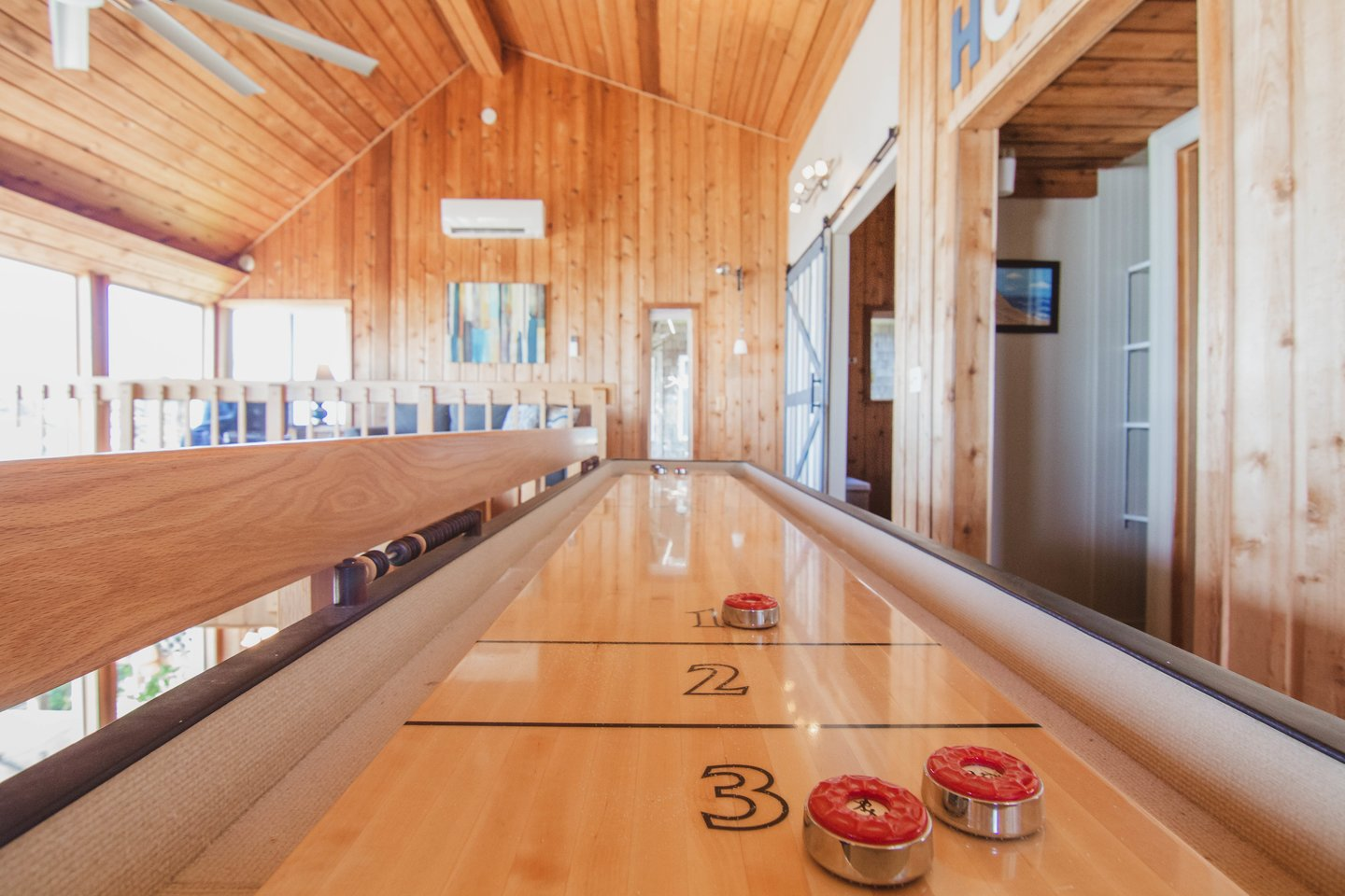 Enjoy a game of shuffleboard upstairs.