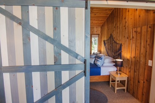 Beautiful barn doors close off both upstairs bedrooms.