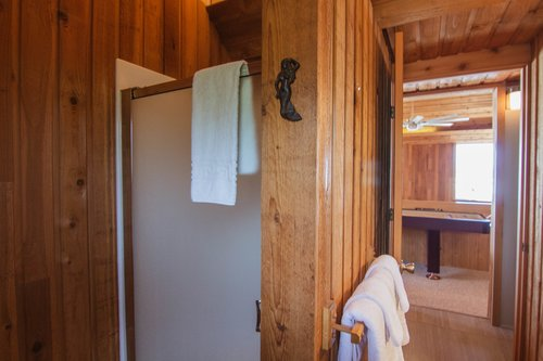 The bathroom upstairs is shared by both bedrooms.
