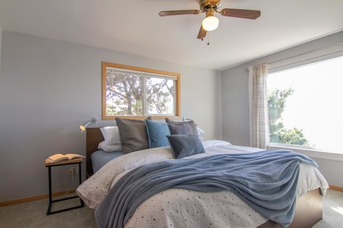 The bright and airy master bedroom upstairs has fantastic ocean views.