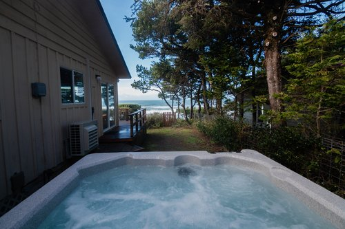 Enjoy the hot tub while listening to the ocean waves.