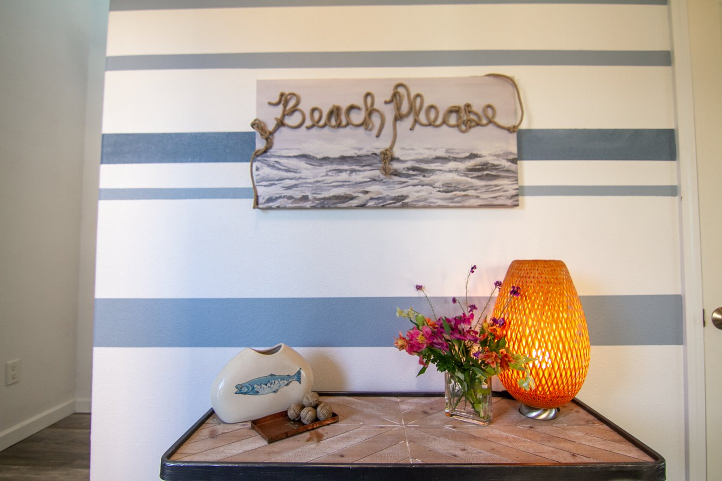 How many times can you find 'Beach, Please' in this adorable house?