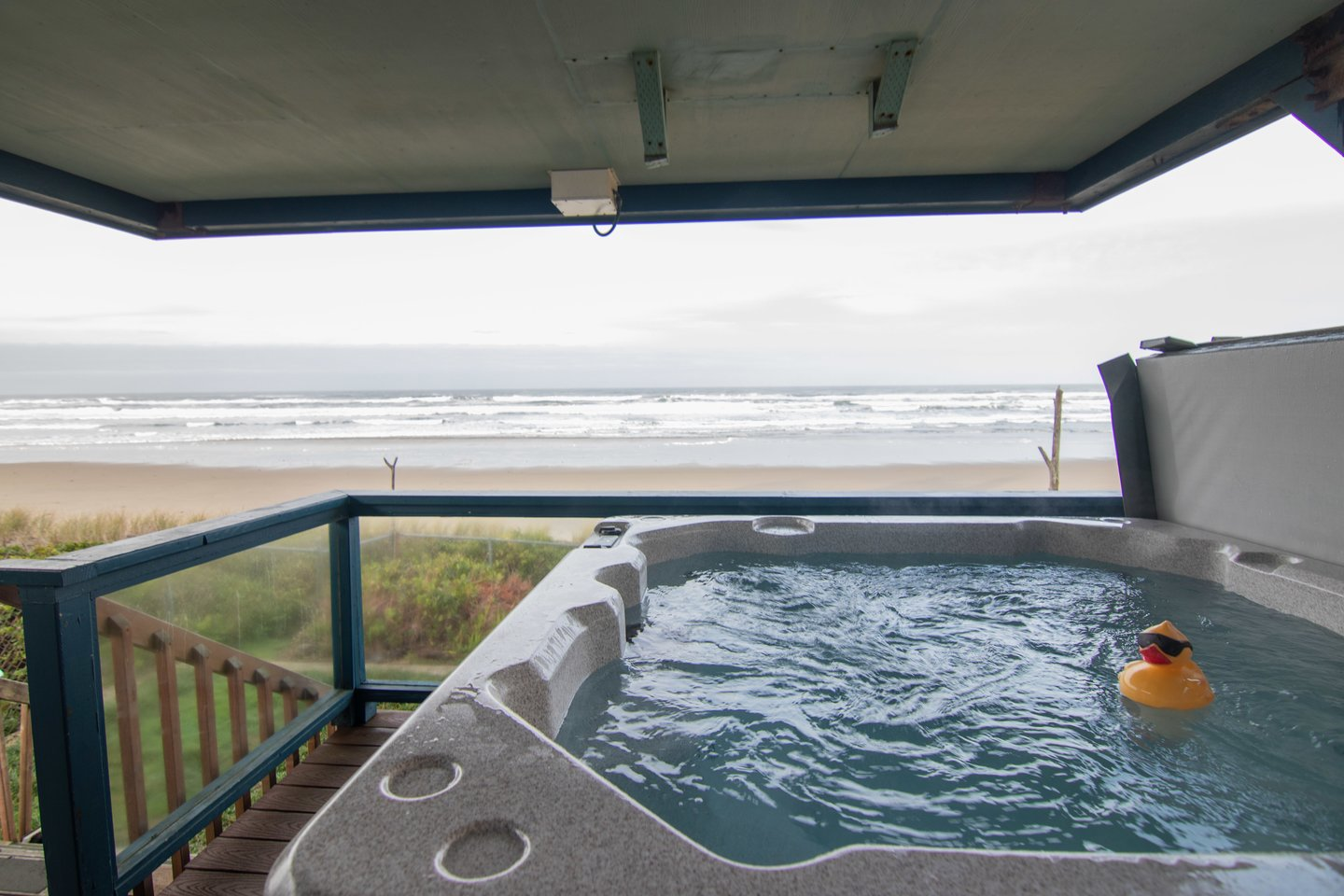 Relax in the hot tub right on the deck with ocean views!