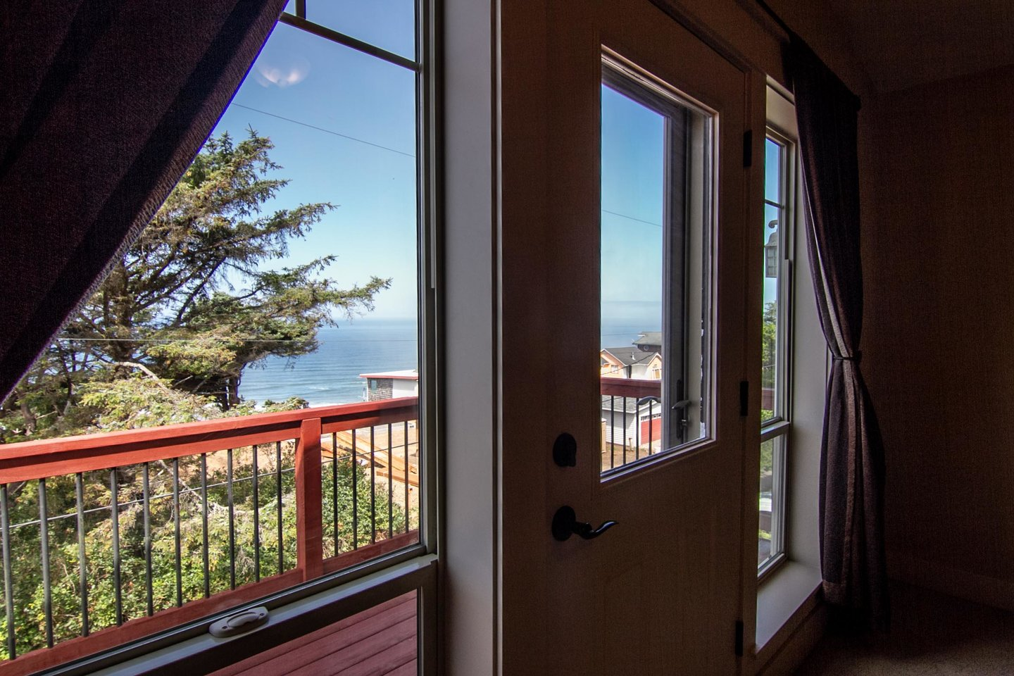 Open the door to your private deck and listen to the waves.