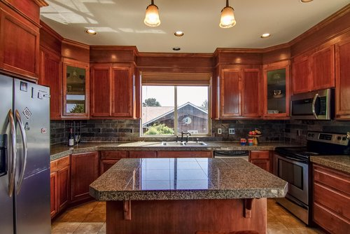 The large kitchen island is perfect for prepping your dinner.