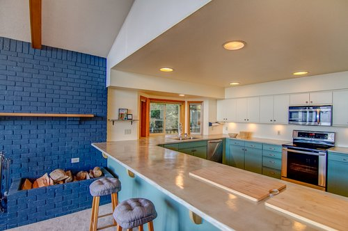 The spacious kitchen with bar seating is great to cook dinner together.