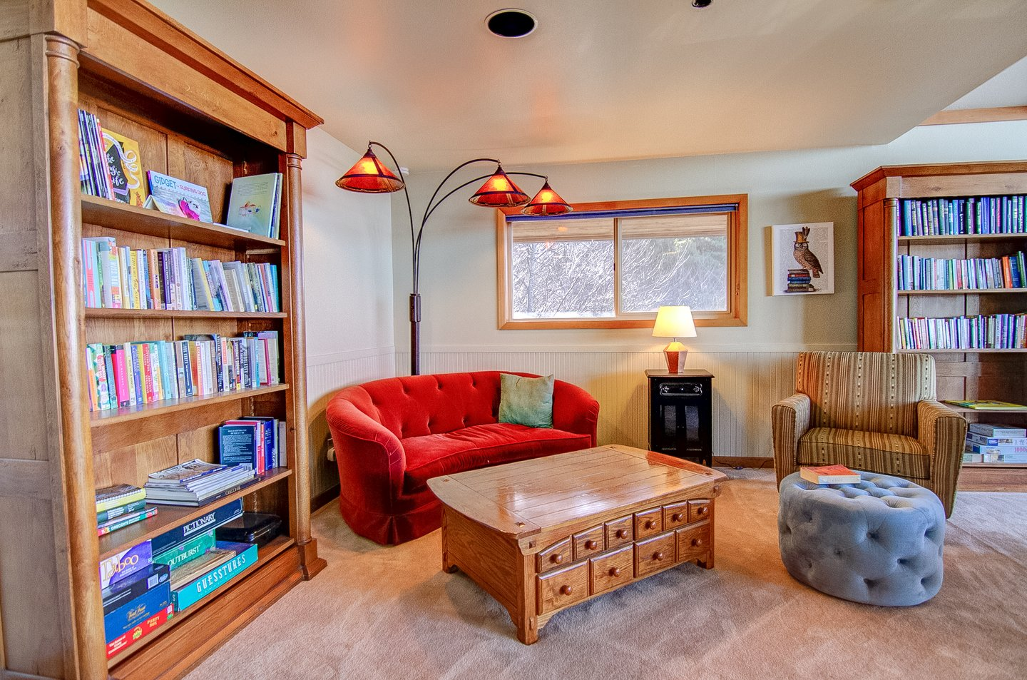 Curl up and read a book in this cozy corner.