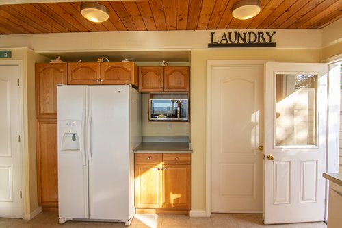 The laundry room is right off the kitchen.