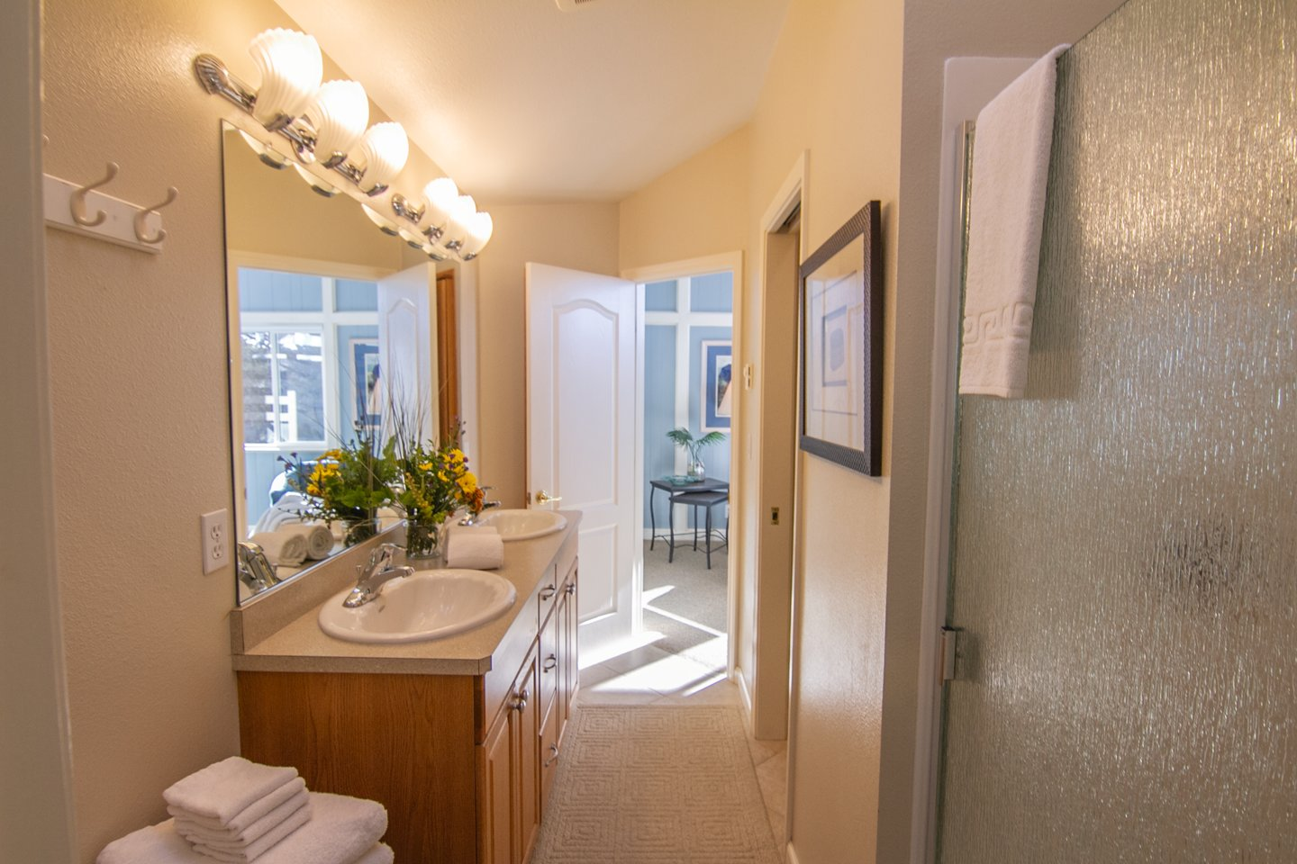 The jack and jill bathroom upstairs with a double vanity gives everyone plenty of privacy.